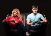 Couple  sitting separately with smarthones — Stock Photo