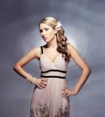 Young blond woman in dress — Stock Photo