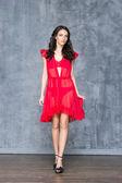 Woman posing in beautiful red dress — Stock Photo
