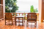 Two chairs and table on balcony — Stock Photo