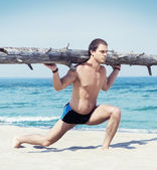 Athletic man training  on beach — Stock Photo