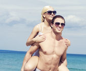 Couple in love on summer beach — Stock Photo