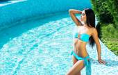 Sporty woman relaxing in pool — Stock Photo