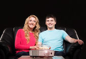 Couple watching movie on laser projector — Stock Photo