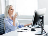Confident  woman working in office — Stock Photo