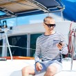 Young and handsome man on a sailing boat — Stock Photo #76430009