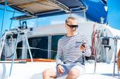 Young and handsome man on a sailing boat — Stock Photo