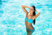 Sporty woman swimming in pool — Stock Photo