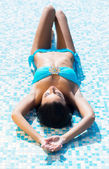 Woman relaxing near pool — Stock Photo