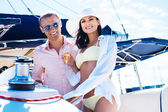 Rich couple  on a luxury boat — Stock Photo