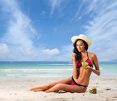 Sexy woman relaxing on  beach — Stock Photo