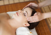 Woman on spa massage procedure — Stock Photo