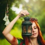 Постер, плакат: Beautiful red hair girl with deep green eyes