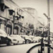 Blurred image of city street with bicycle — Stock Photo #53537827