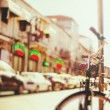 Blurred image of city street with bicycle — Stock Photo #53537833