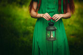 Woman holding lantern with candle — Stock Photo