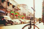 Blurred image of city street with bicycle — Stock Photo