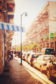 Blurred image of city street at sunset — Stock Photo