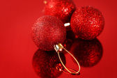 Christmas card with red baubles and sparkles — Stock Photo