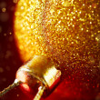 Christmas card with gold baubles and sparkles — Stock Photo #55346643