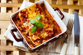 Italian Food. Lasagna plate with fresh basil. — Stock Photo