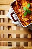Italian Food. Lasagna plate on wooden table. — Stock Photo