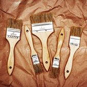 Set of five renovation brushes on craft paper — Stock Photo