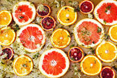 Ripe red oranges and grapefruits cut by rings — Stock Photo