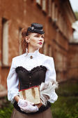 Beautiful redhair woman in vintage clothes — Stock Photo