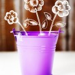 Spring concept with purple bucket and flowers — Stock Photo #65464565