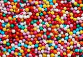 Colorful sweet background with different sprinkles — Stock Photo