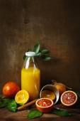 Still life with orange fruit and juice — Stock Photo