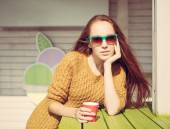 Beautiful redheaded girl in sunglasses for summer outdoor cafe table — Stock Photo