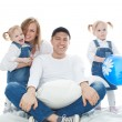 Family, father sitting on a cushion behind it little girls twins and a beautiful wife, isolation — Stock Photo #71587351
