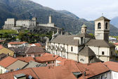 The Collegiate Church and fort Castelgrande at Bellinzona on the — Zdjęcie stockowe
