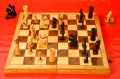 Chess board on red background — Stock Photo