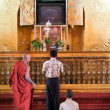 People praying at Mahamuni Buddha temple in Mandalay, Myanmar — Stock Photo #58800967