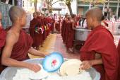 Monks in a row at Mahagandayon Monastery — Stock Photo