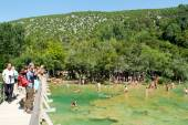 Tourists walking and swimming at the Krka national park — Stock Photo