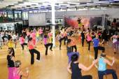 People dancing during Zumba training fitness at a gym — Stockfoto