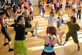 People dancing during Zumba training fitness at a gym — Stock Photo