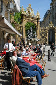 People eating and drinking in a restaurant of Nancy — Stok fotoğraf