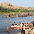 People crossing the river by boat at Hampi on India — Stock Photo #64771015