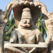 Statue of Lakshmi Narasimha at Hampi on India — Stock Photo #65522543