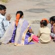 Indian family sitting on the ground — Stock Photo #65891145