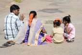 Indian family sitting on the ground — Stok fotoğraf