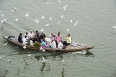 Tourists taking a boat tour on the sacred Ganges river — Stock Photo