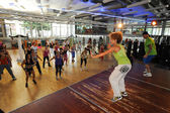 People dancing during Zumba training fitness — Stock Photo