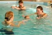 Early development swim teaching class for infants — Stock Photo