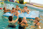 Early development swim teaching class for infants — Stock Photo